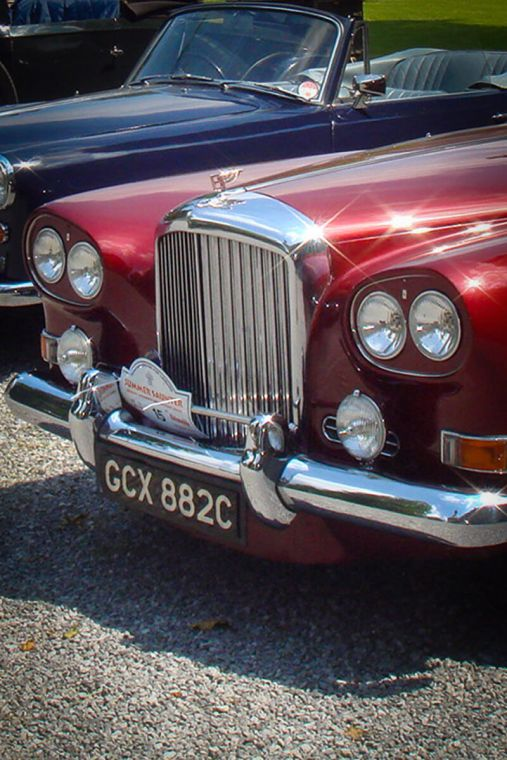 Red rolls royce close up photography.