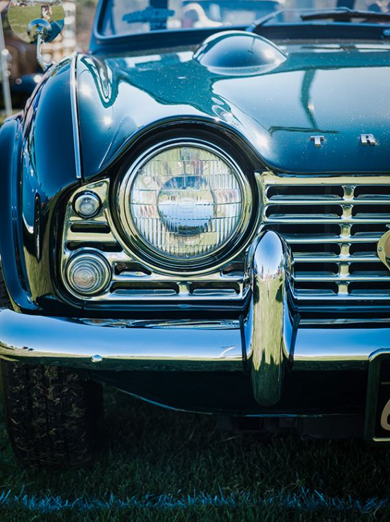 Blue classic car in close up photography.