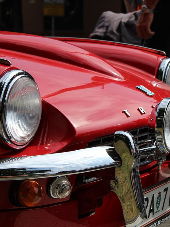 Red triumph classic car with close up photography.